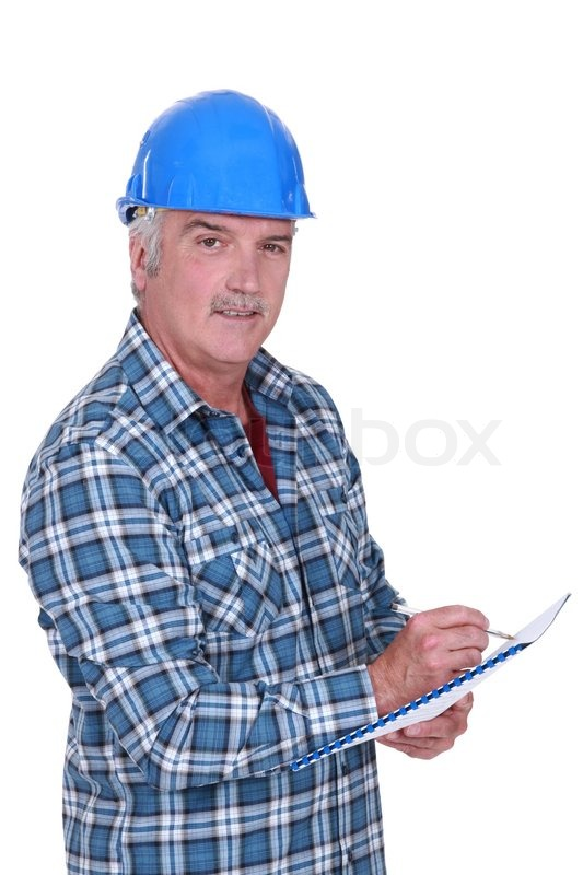 Construction Foreman Evaluating An Employee Stock Photo