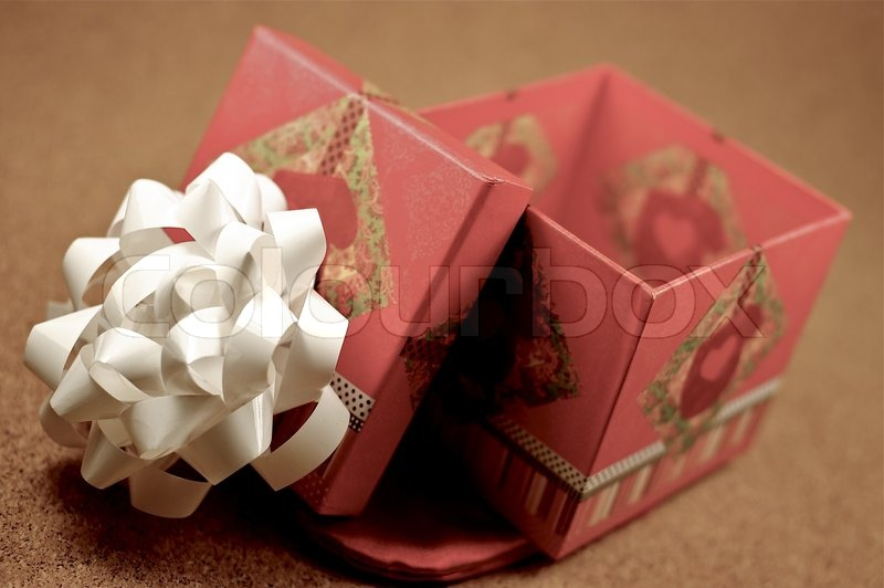 Open Gift Box. Opened Gift Bow with White Bow on the Top. Small Gift Box, stock photo