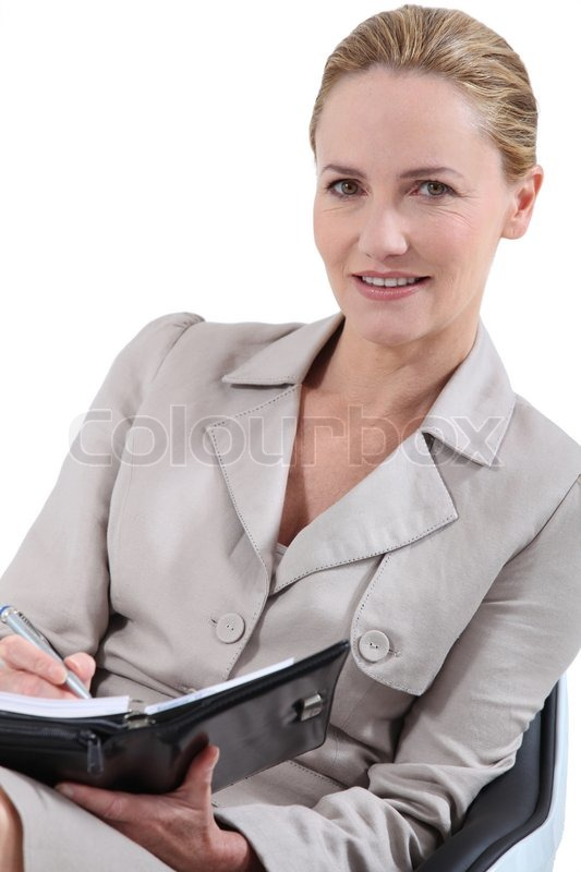 Professional blonde woman with a personal organizer | Stock Photo |  Colourbox