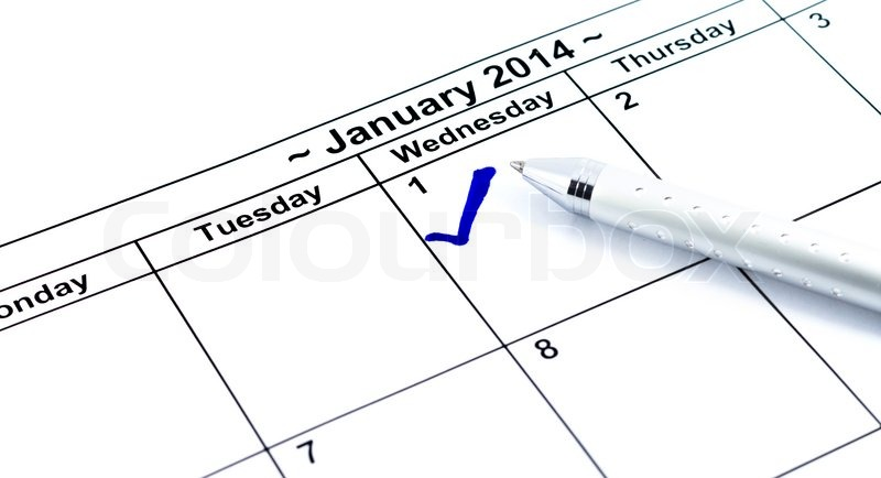 Blue check. Mark on the calendar at 1St January 2014 with pen, new year\'s day, stock photo