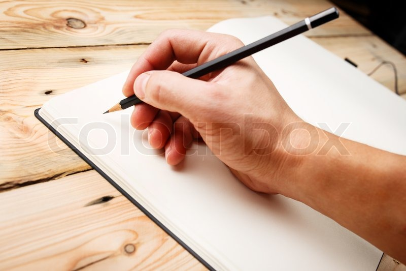 In Search Of Inspiration. A man with an empty notebook. , stock photo