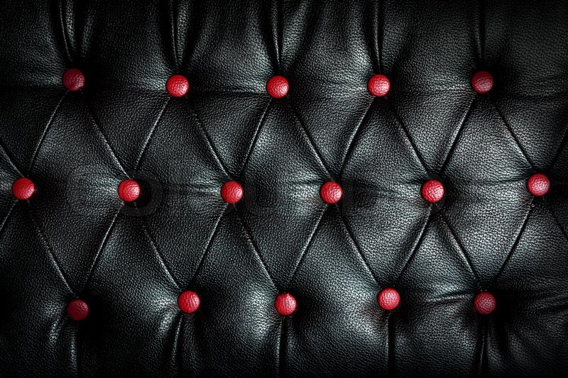 Abstract Black Leather Against Red Dot Stock Image