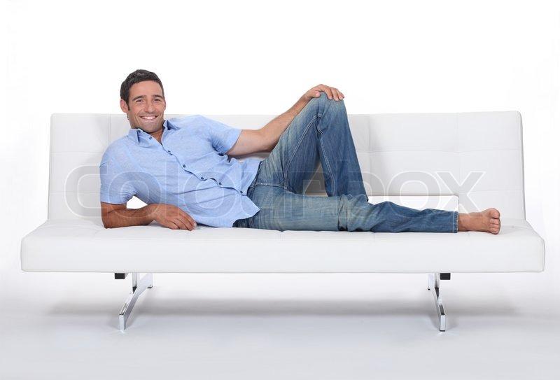 barfu mann liegend auf einer couch stockfoto colourbox. Black Bedroom Furniture Sets. Home Design Ideas