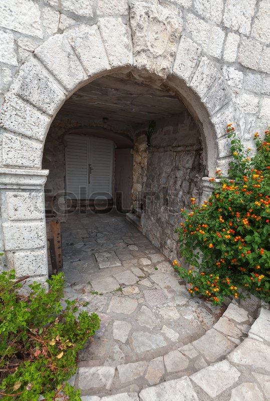 Stone Arch Entrance To Ancient House Stock Photo