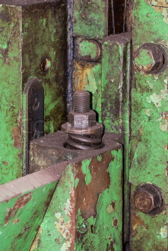 Old metal construction bonded bolts and nut, stock photo