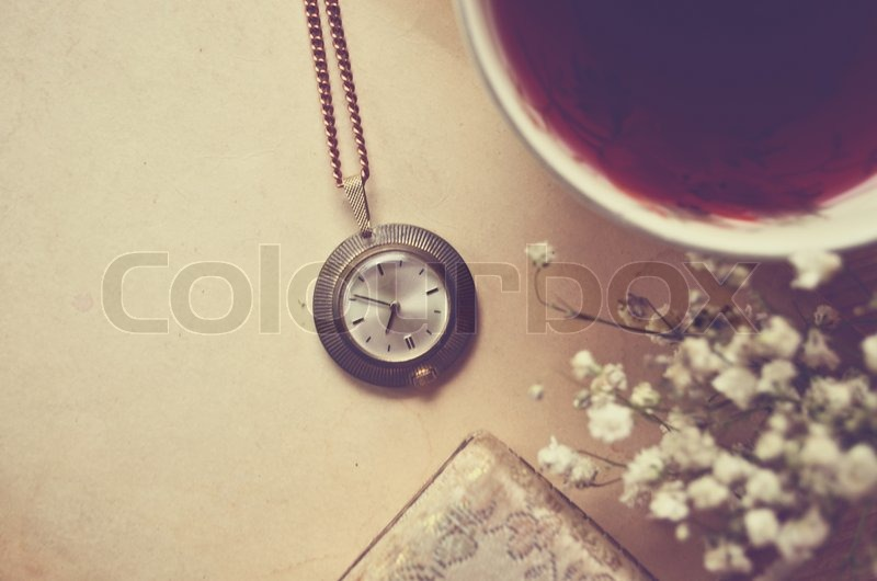 Old blank paper and old watch with cup of tea, stock photo