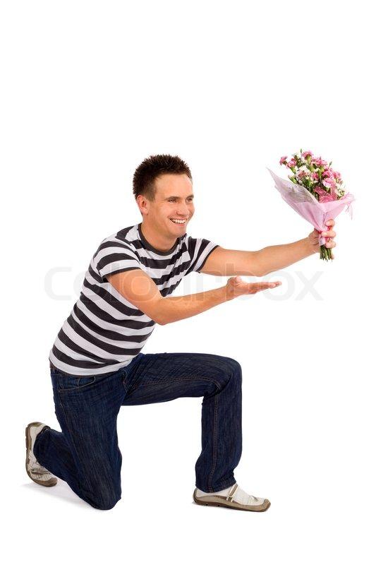 Handsome casual young man handing over bouquet of for Bouquet de fleurs homme