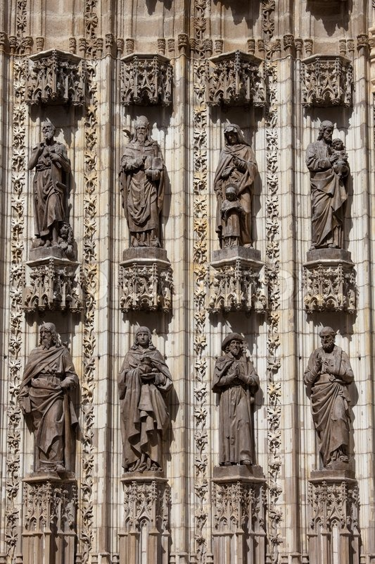 Sculptures of Saints on Seville Cathedral Facade, stock photo