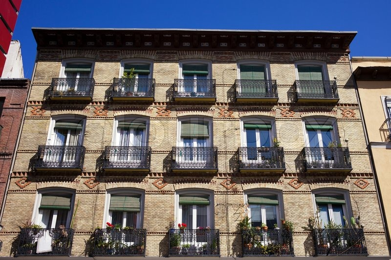 Old apartment building with balconies brick facade in ...