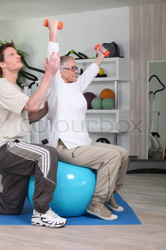Stock image of 'Older woman working out'