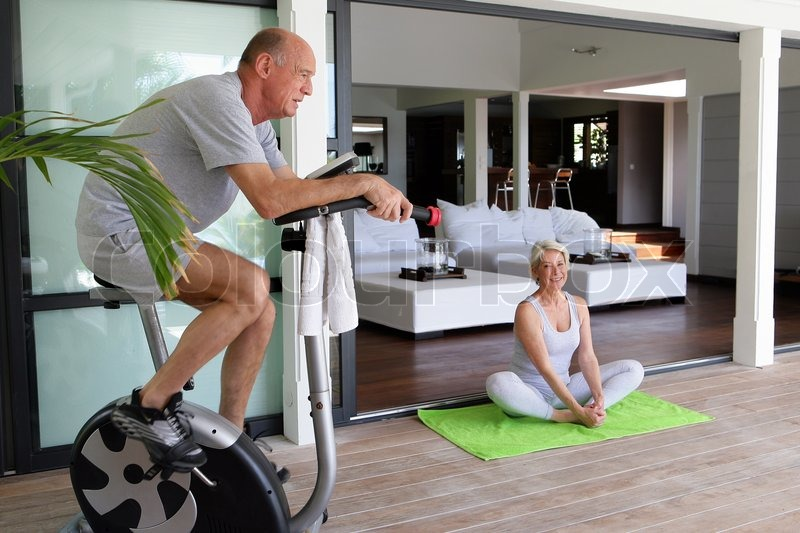 Elderly couple working out at home stock photo colourbox