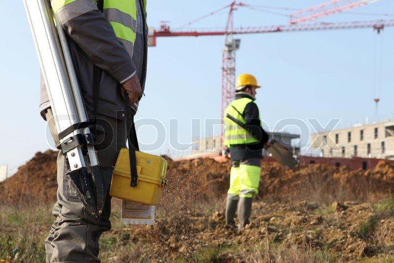 Civil engineers onsite, stock photo