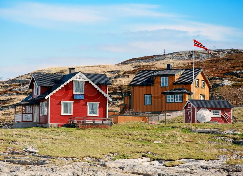 Norwegian village with colorful wooden houses on rocky sea for Norway wooden houses