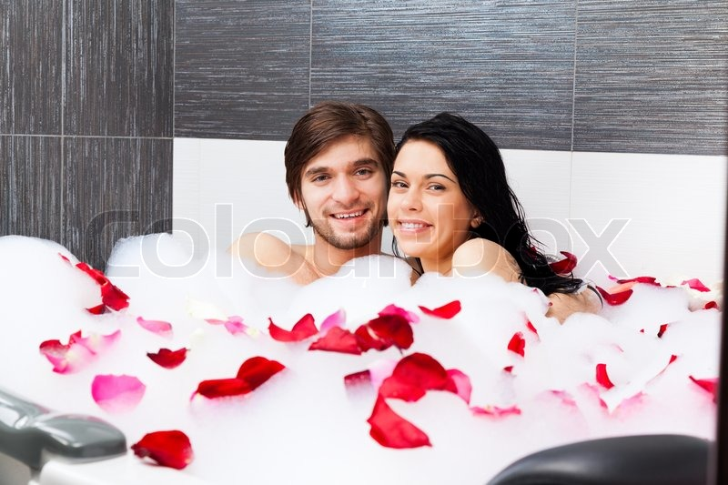 Young Couple In Bathroom Taking Bath Together