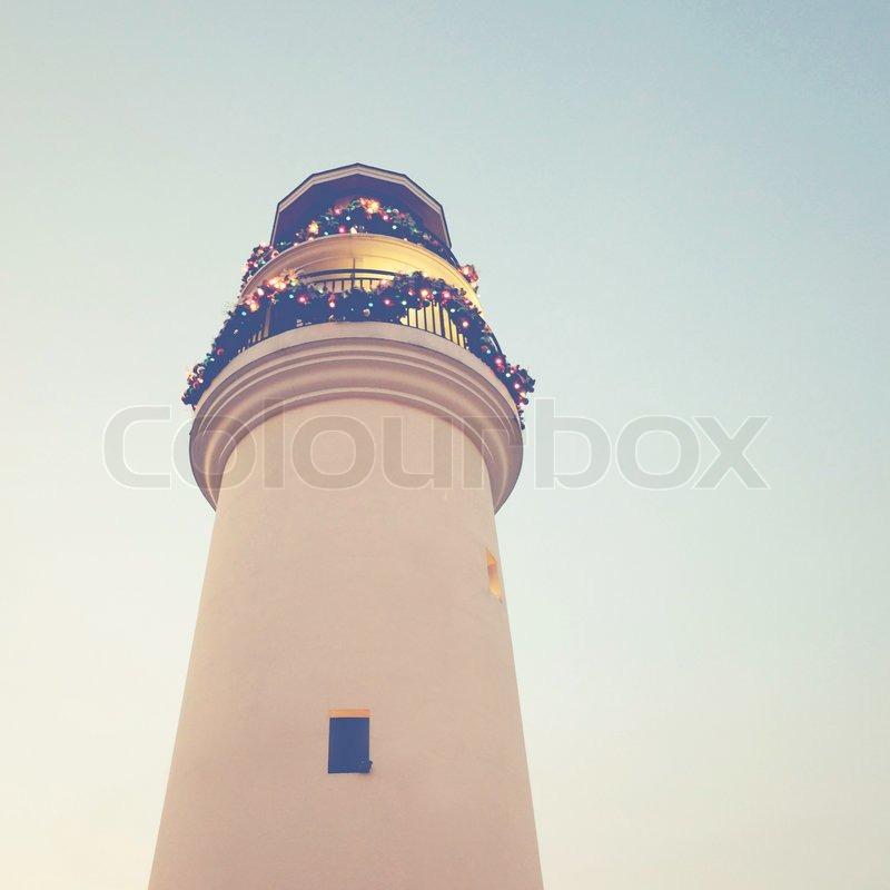 Leuchtturm mit christbaumschmuck retro stockfoto colourbox - Christbaumschmuck leuchtturm ...