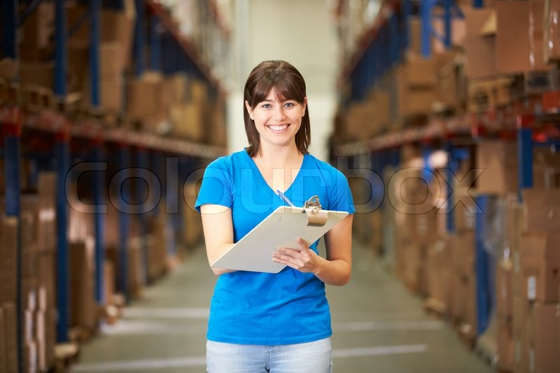 Female Worker In Distribution Warehouse, stock photo