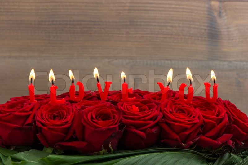 Red Roses And Burning Candles Making I Stock Photo Colourbox