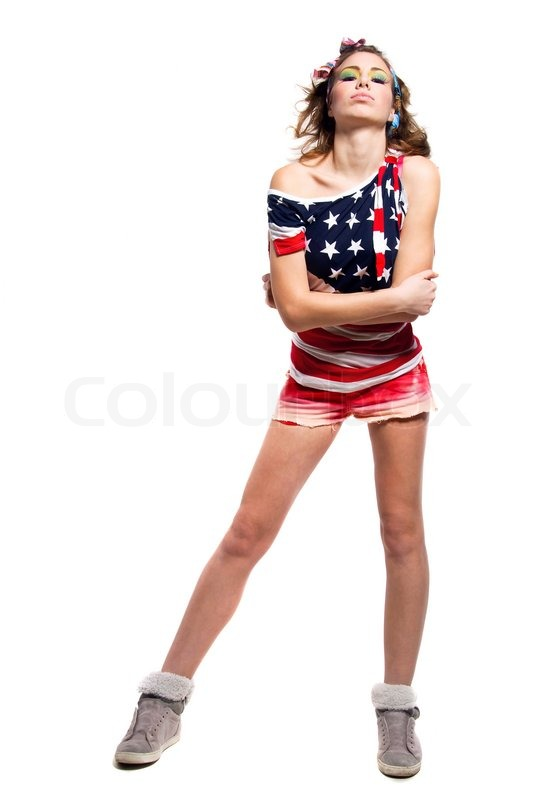 Young american patriotic girl wearing colorful head band red shorts