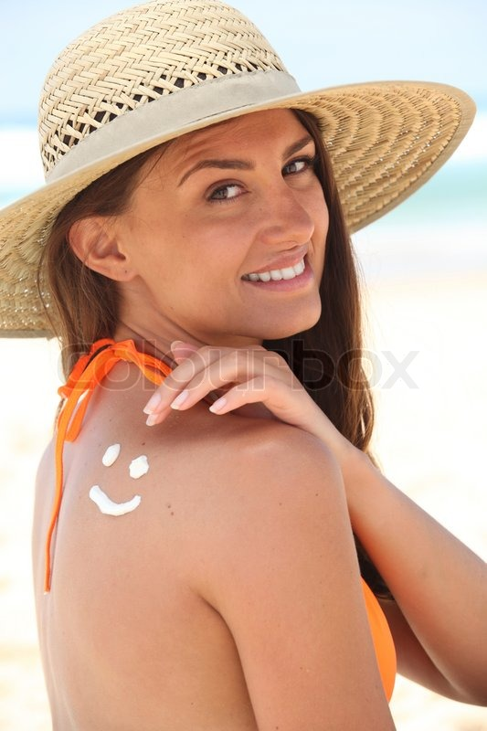 Stock image of 'Woman with sunscreen'
