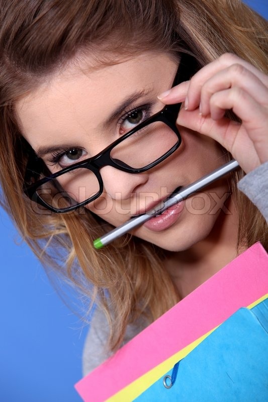 girl with a pencil in her mouth stock photo colourbox
