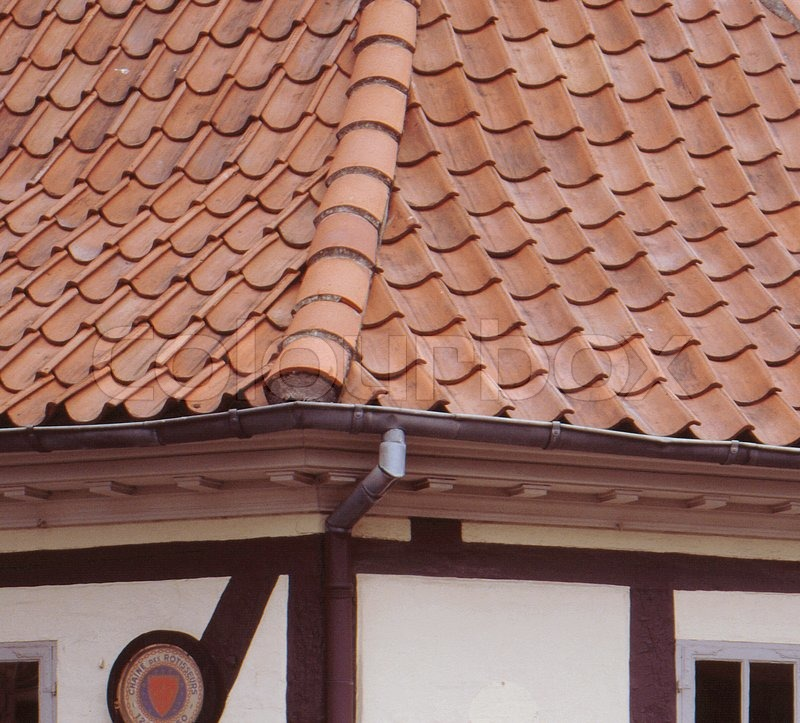 Close-up on brick roof and rain gutter of scandinavian house, stock photo