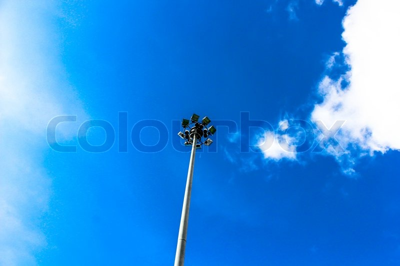 spotlight projection tower of football field isolated blue sky background