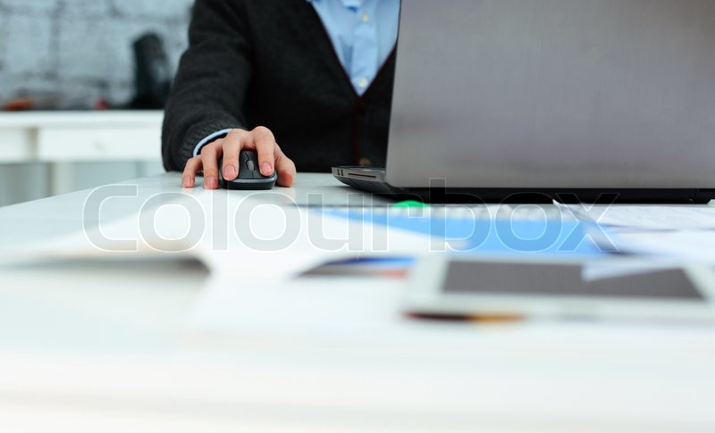 Stock image of 'Closeup image of a man working at laptop at his workplace'