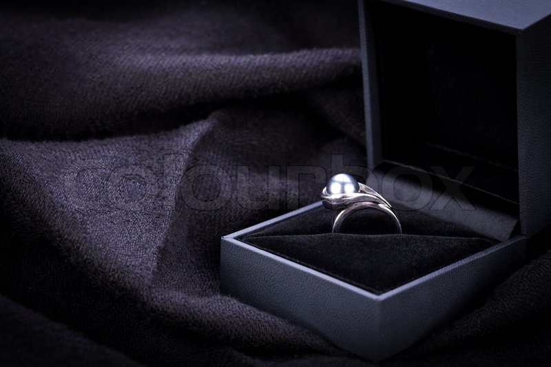 Dark Mysterious Image Of A Glowing Diamond Engagement Ring Displayed