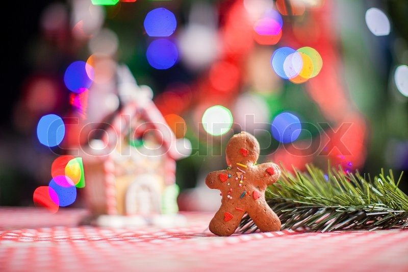 close up of gingerbread man background candy ginger house and christmas tree lights stock photo colourbox
