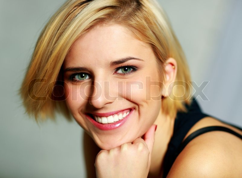 Closeup portrait of a young smiling woman, stock photo