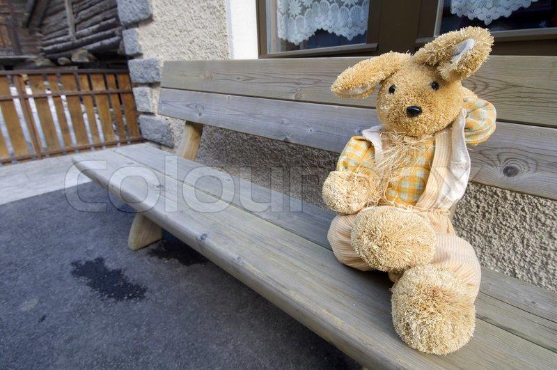 Stuffed animal sitting on a bench in the village of Zermatt, Alps, Switzerland, stock photo