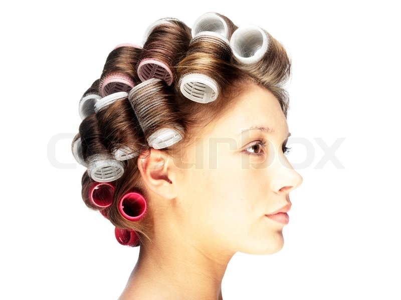 side view of a woman with hair curlers stock photo colourbox
