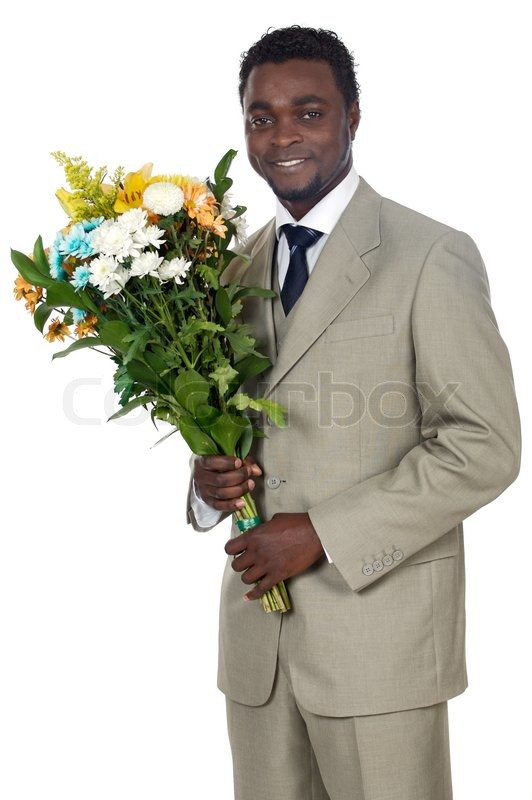 Attractive black man with bunch of flowers | Stock Photo | Colourbox