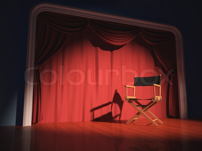 Director\'s chair on the stage illuminated by floodlights, stock photo