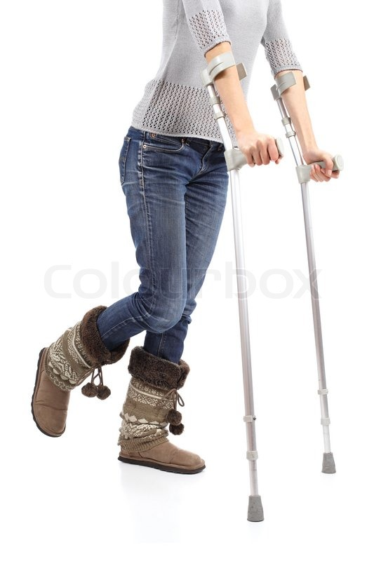 Close Up Of A Casual Woman Walking With Crutches Isolated