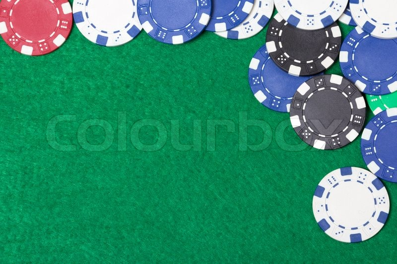 Poker chips on a green casino table background, stock photo