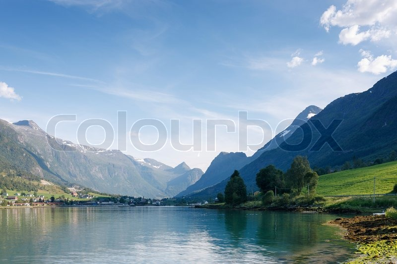 Nordfjord olden city norway stock photo colourbox - The house on the rock the ultimate refuge in a norwegian fjord ...