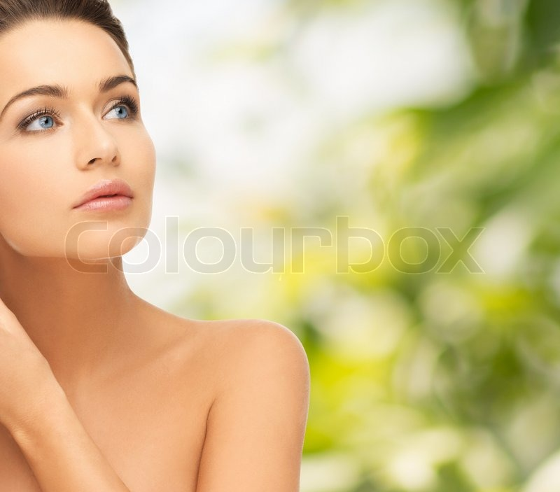 Beauty and health concept - beautiful woman looking up, stock photo