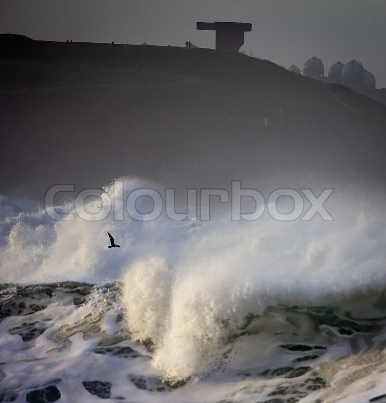 Rough seas landscape in the Gijón bay, in the north of Spain, stock photo