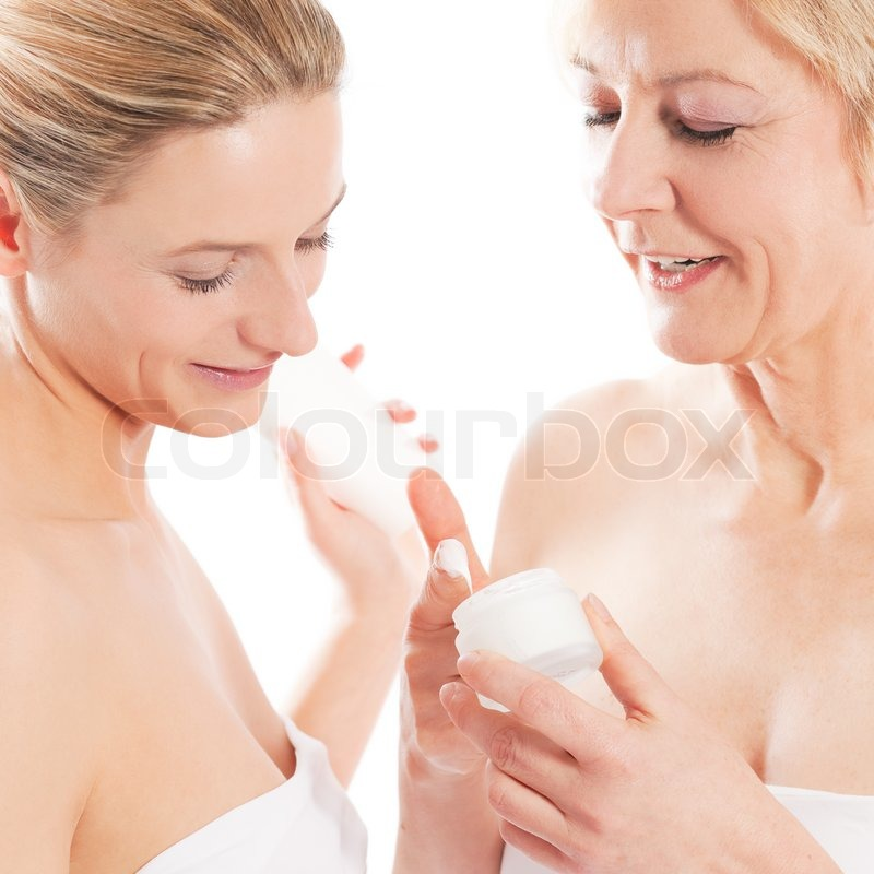 Beauty and skin care - mother and daughter with cream, stock photo