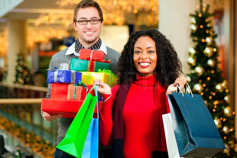 Couple - Caucasian man and black woman - with Christmas ...