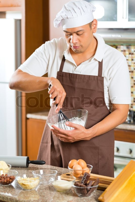Asian Man Baking Homemade Cake In His Kitchen For Dessert | Stock Photo |  Colourbox