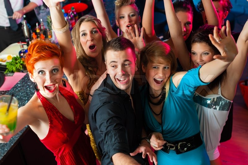 Group Of Young People Having Fun In Busy Bar Stock ...  |People Having Fun In A Club