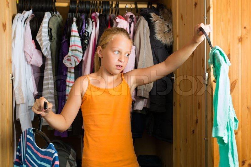 Family   Child Or Teenager In Front Of Her Closet Or Wardrobe And Looking  For Outfit | Stock Photo | Colourbox