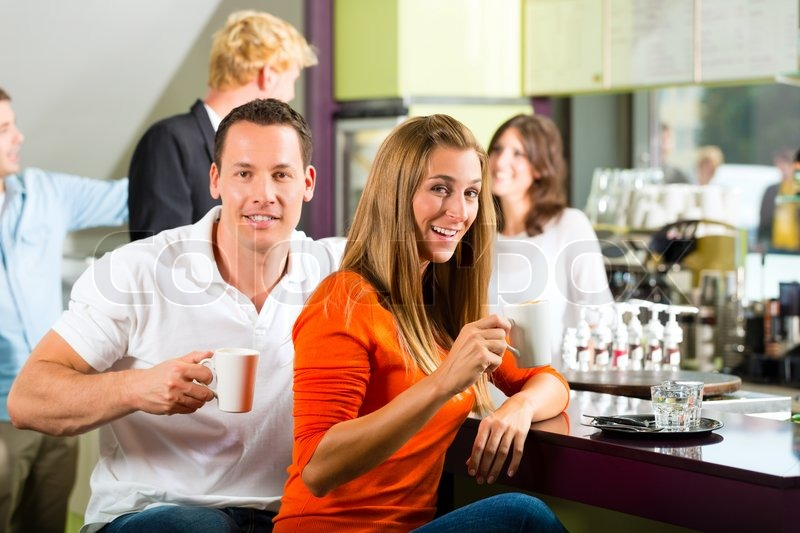 Group of people in Cafe drinking coffee ... | Stock image | Colourbox