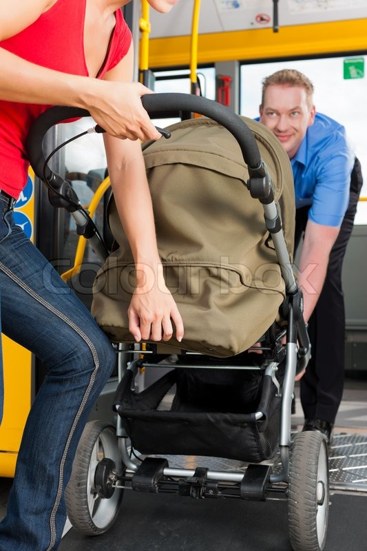 Young woman with a baby in a stroller getting into a bus on