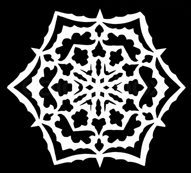 Black And White Snowflake Background Hand Made Cut Out White Snowflake on Black Paper Background Stock Photo