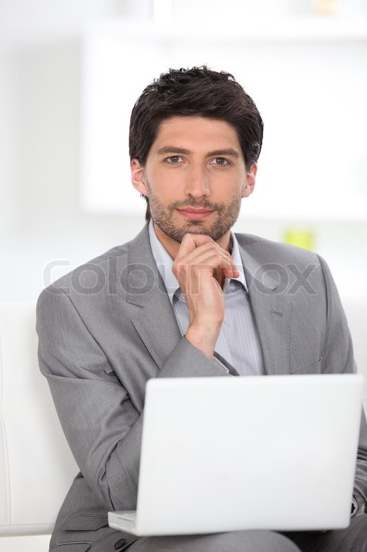 Businessman sat in waiting area, stock photo