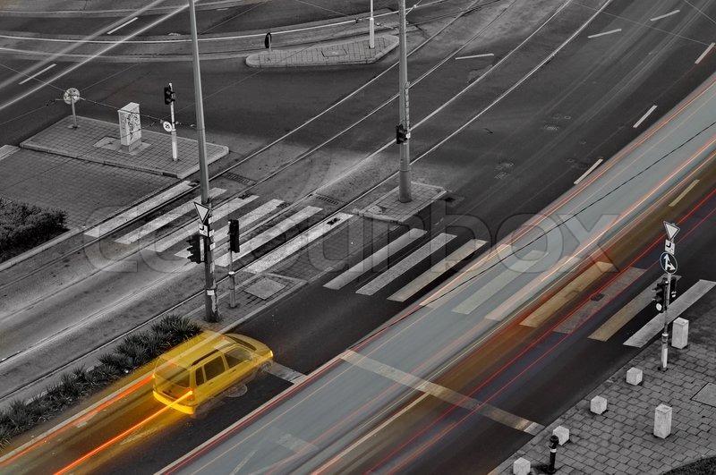 Yellow car stops at crossing, stock photo
