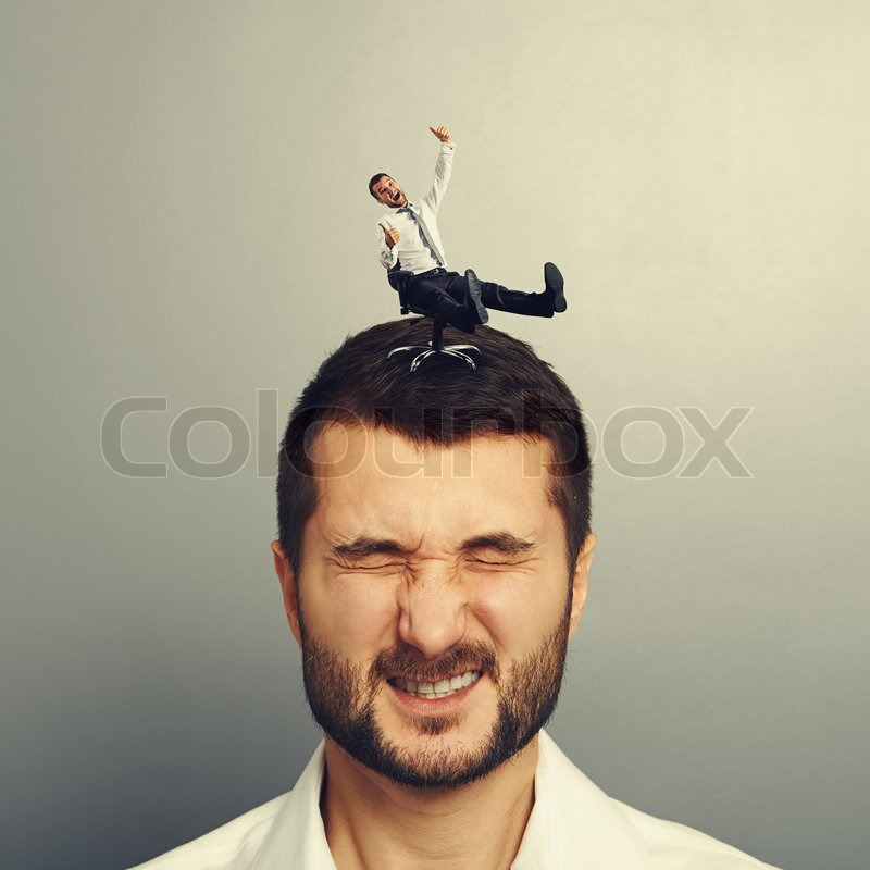 Crazy man rolling on the head of another man, stock photo